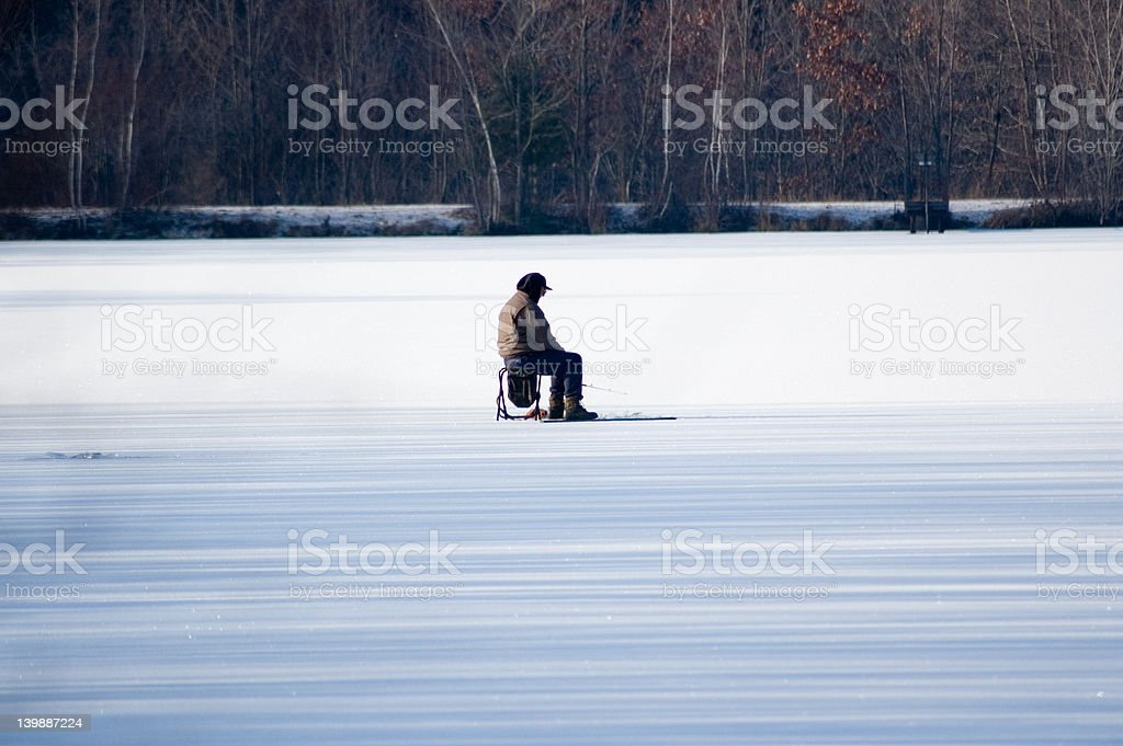 man ice fishing stock photo