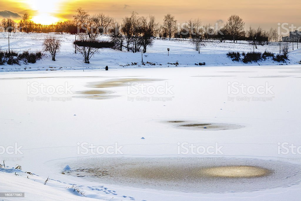 Man ice fishing royalty-free stock photo