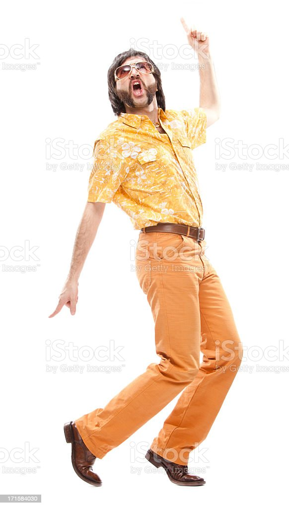 Man in 1970's yellow Hawaiian shirt while disco dancing royalty-free stock photo