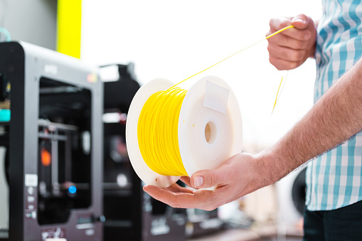 Man In 3d Printer Office Holding Filament Stock Photo - Download Image Now