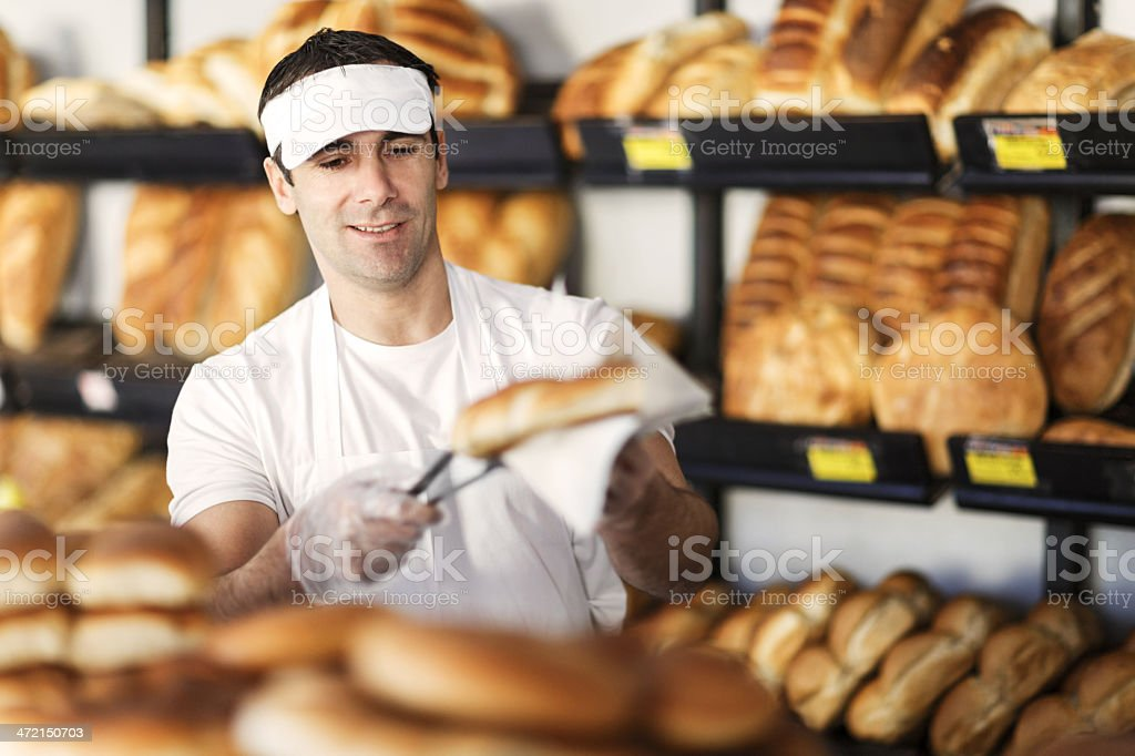 Man in a bakery. stock photo