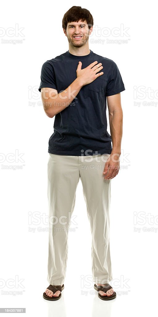 Man in a blue shirt and sandals with hand over heart stock photo