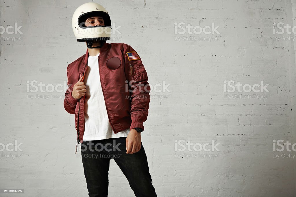 Man in a bordeaux pilot jacket with helmet Lizenzfreies stock-foto