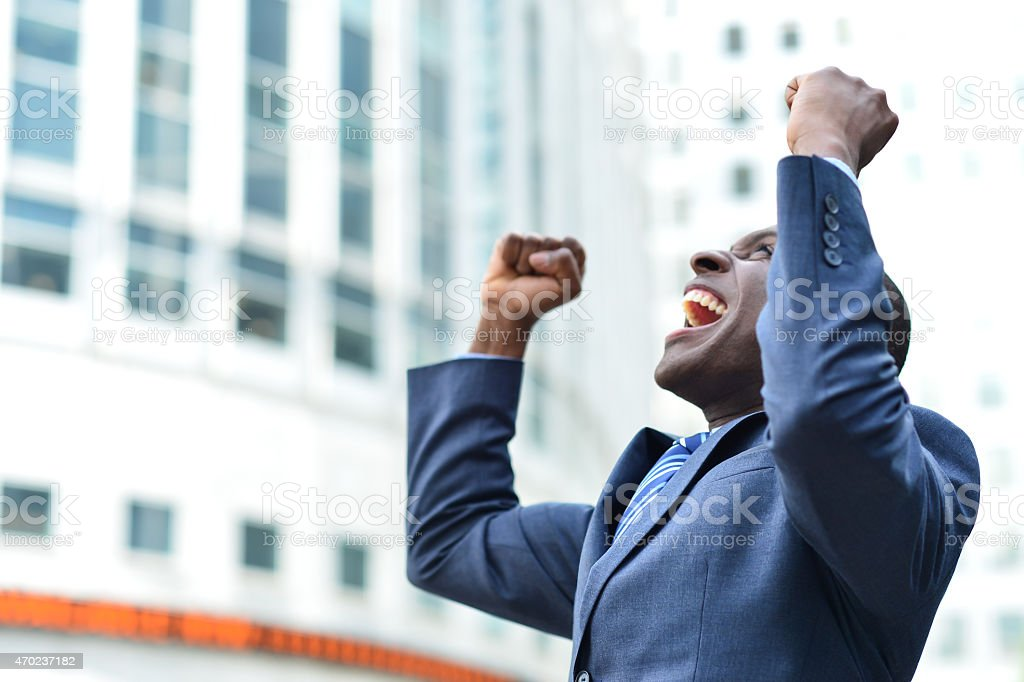 Man in a business suit shouting from excitement stock photo
