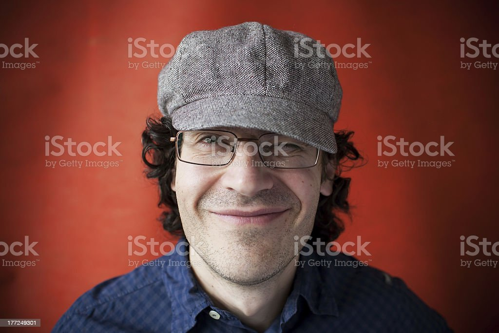 Man in a cap and glasses stock photo