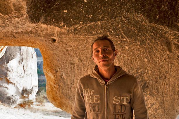 Man in a cave, Cappadoccia, Turkey stock photo