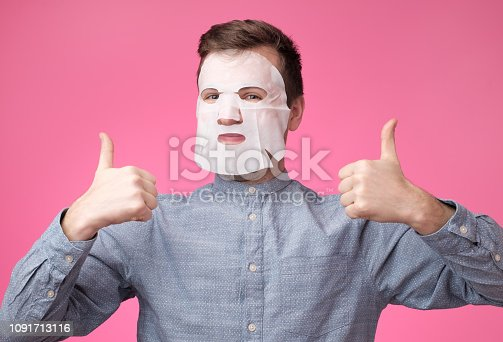 istock man in a cosmetic mask for skin care showing thumb up 1091713116