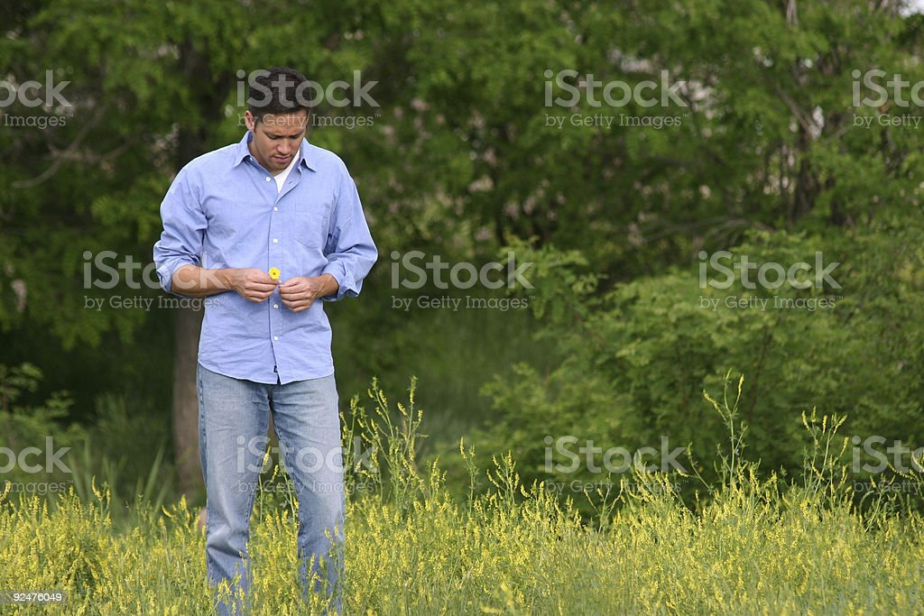 man in a field royalty-free stock photo