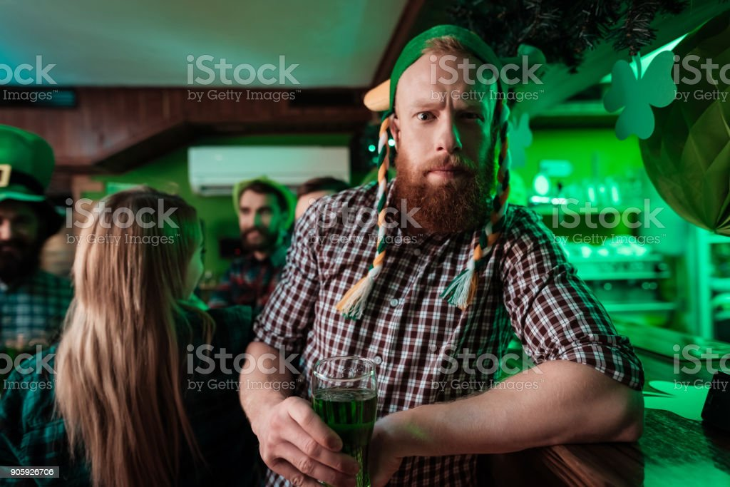 A man in a funny hat celebrates St. Patrick's Day. stock photo
