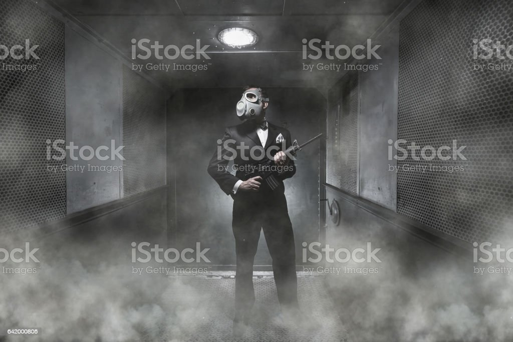 A man in a gas mask stock photo