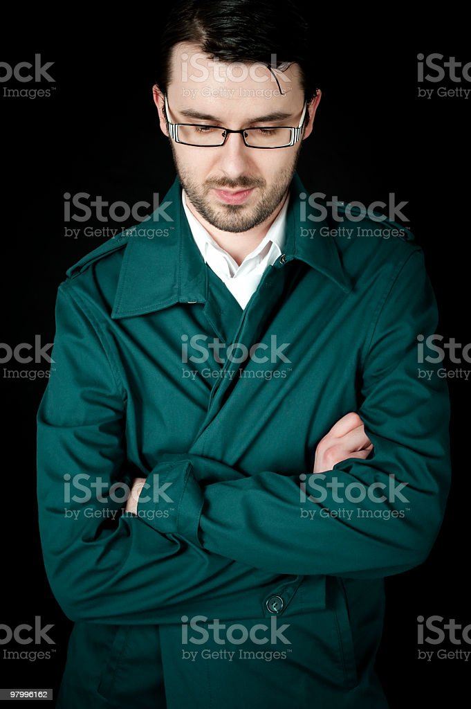 man in a green coat royalty free stockfoto