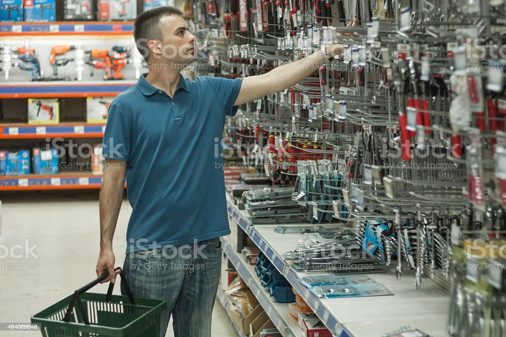Man in a hardware store. stock photo