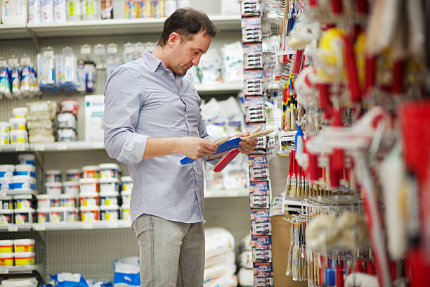 man in a hardware store - construction material stock photos and pictures