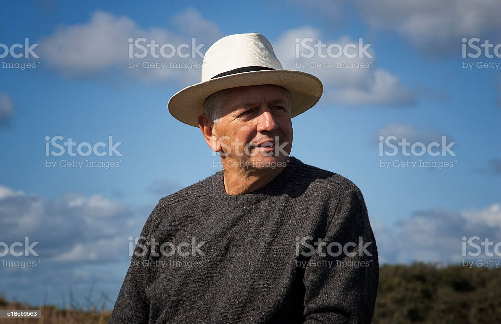 Man in a hat stock photo