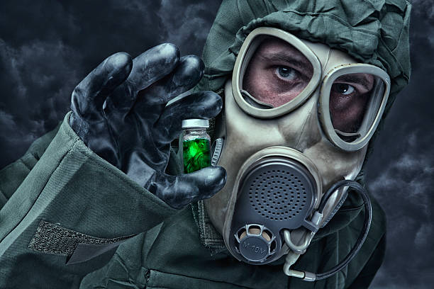 man in a hazmat suit holding vial - white suit stock photos and pictures