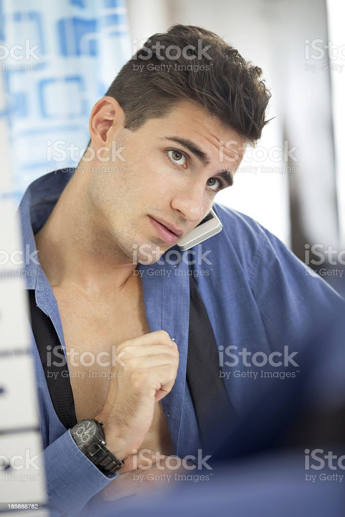 man in a hurry front of  mirror royalty-free stock photo