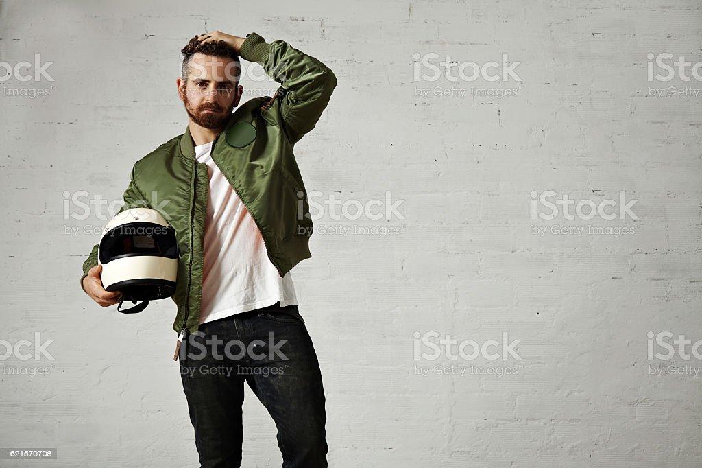 Man in a khaki pilot jacket with helmet photo libre de droits