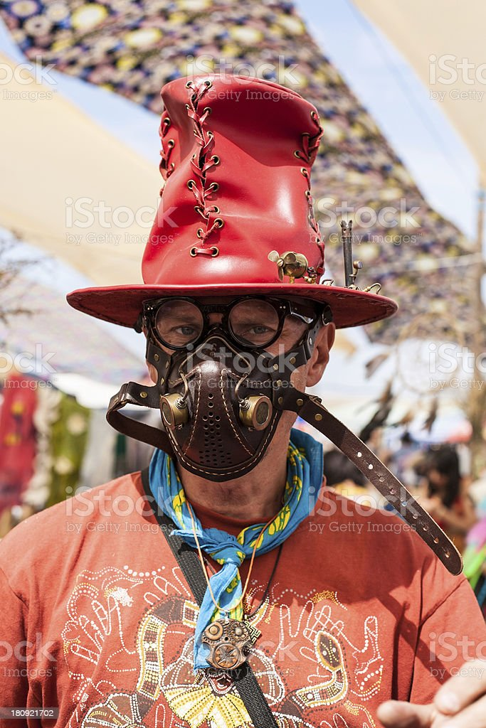 man in a leather mask and red hat royalty-free stock photo