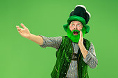 A man in a leprechaun hat at studio. He celebrates St. Patrick's Day.