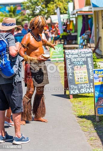 939399010 istock photo A man in a loincloth on a city street. With selective focus. Vertical 1132989249