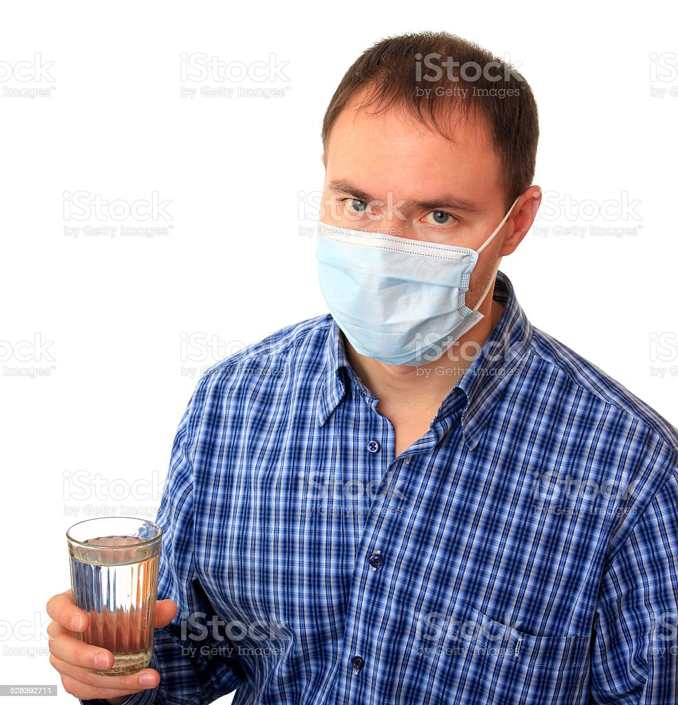 Man in a medical mask with water. stock photo
