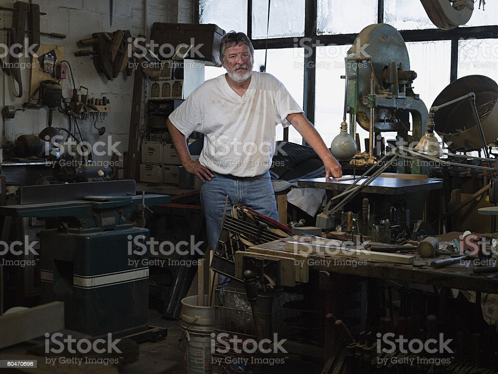 Man in a messy workshop royalty-free 스톡 사진