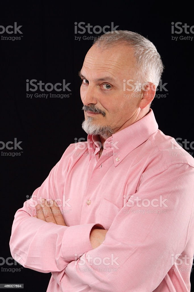 man in a pink shirt posing stock photo