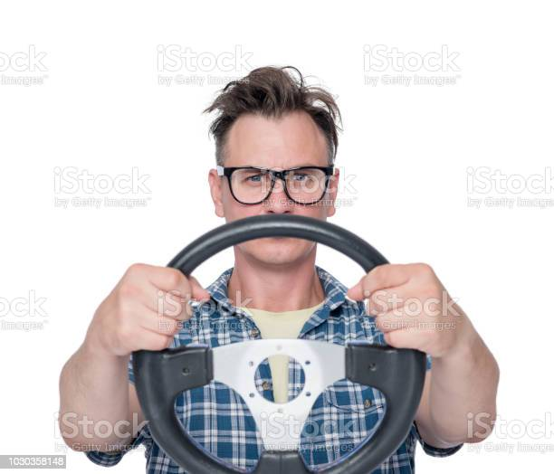 Man in a plain shirt and glasses with steering wheel isolated on picture id1030358148?b=1&k=6&m=1030358148&s=612x612&h=v7nwo1kqssunzv5ko0uxep kur0vjwllbn5g 6dybkc=