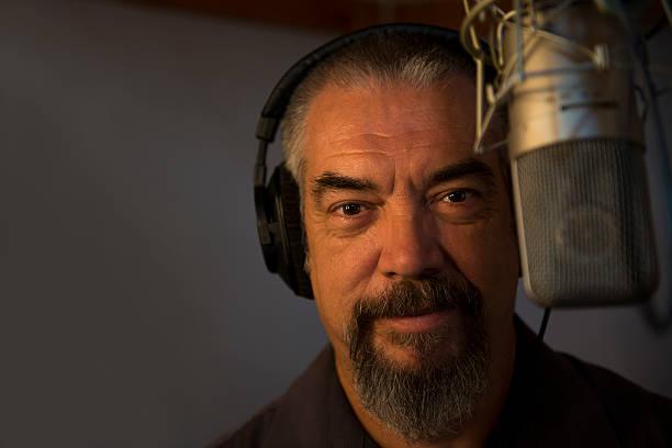 Man in a recording studio stock photo