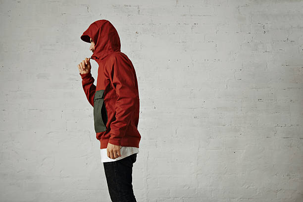 man in a red anorak - mockup outdoor rain foto e immagini stock