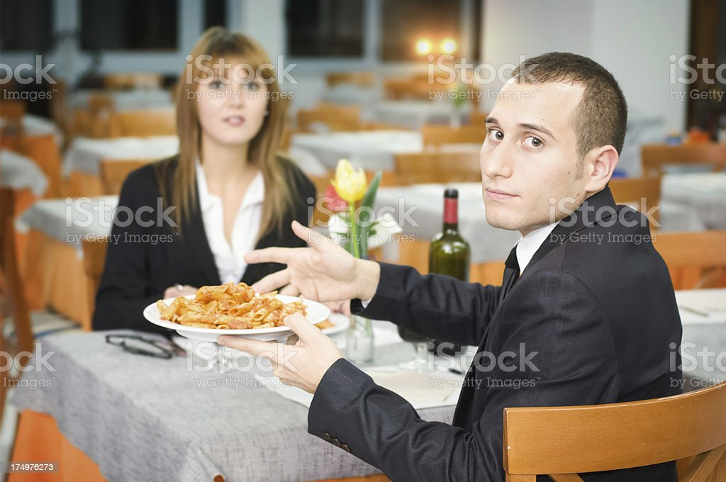 Man in a Restaurant Complaining of Pasta royalty-free stock photo