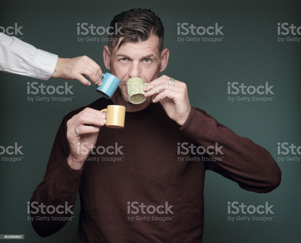 Man in a rush to drink his coffee stock photo
