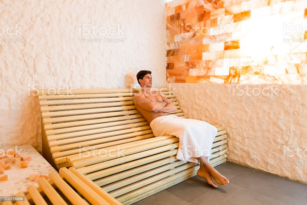 Man in a salt room stock photo
