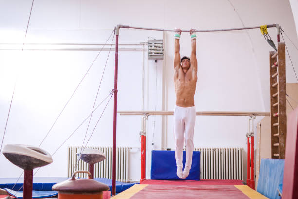 man in a sports hall - horizontal bar stock photos and pictures