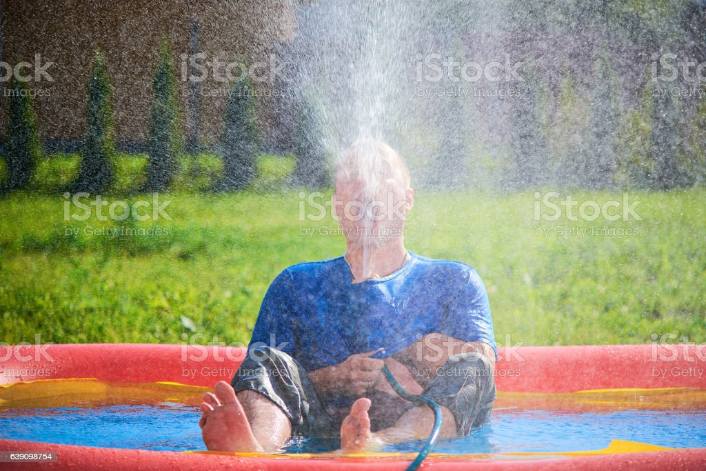 Man in a spray of water stock photo