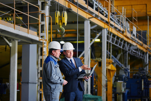 Man In A Suit And A Worker In Overalls Stock Photo - Download Image Now