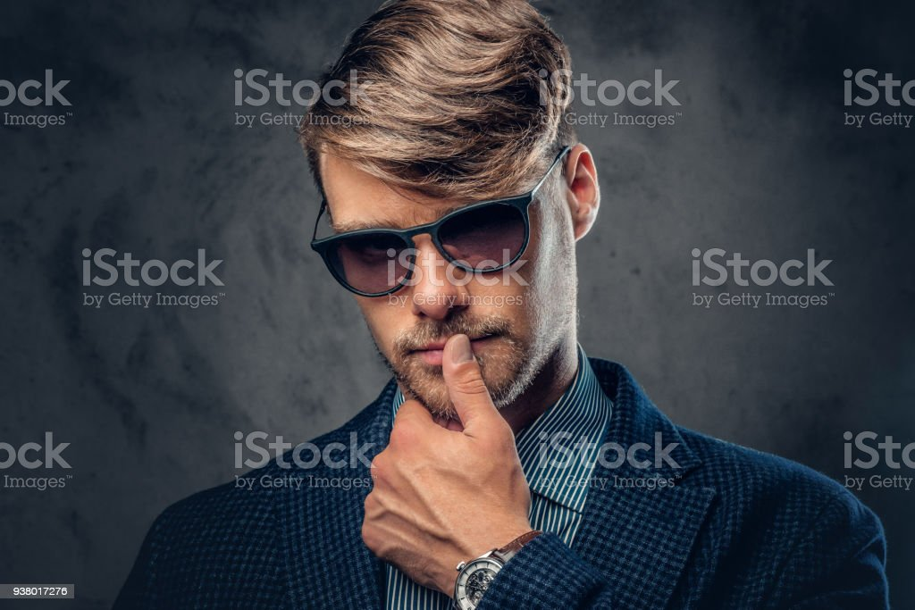 ad577ac5d289 A man in a suit and sunglasses on grey background. royalty-free stock photo
