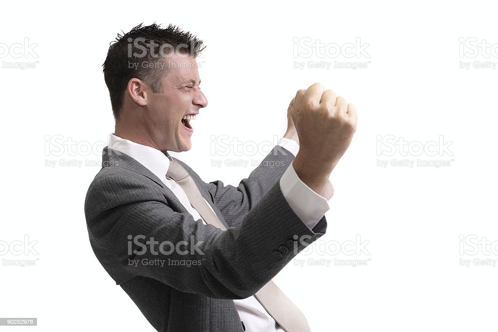 A man in a suit cheering for something royalty-free stock photo