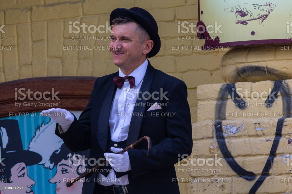 Man in a suit of the famous literary character works for restaurant at Andreevsky descent