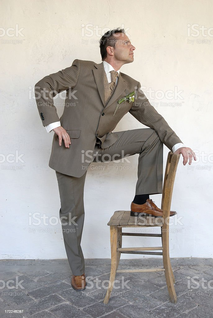 Man in a suit posing for a photo stock photo