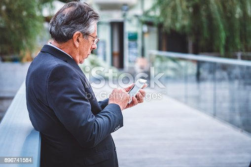 istock Man in a suit typing an important mail 896741584