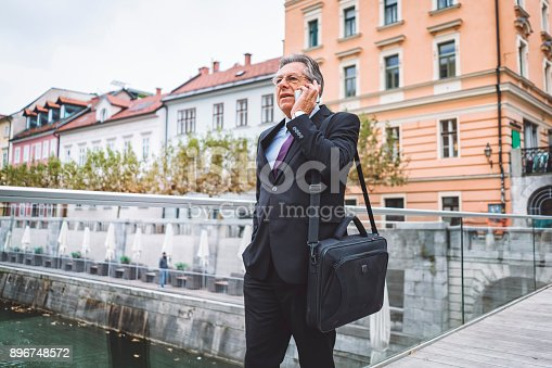 istock Man in a suit walking towards his next meeting 896748572