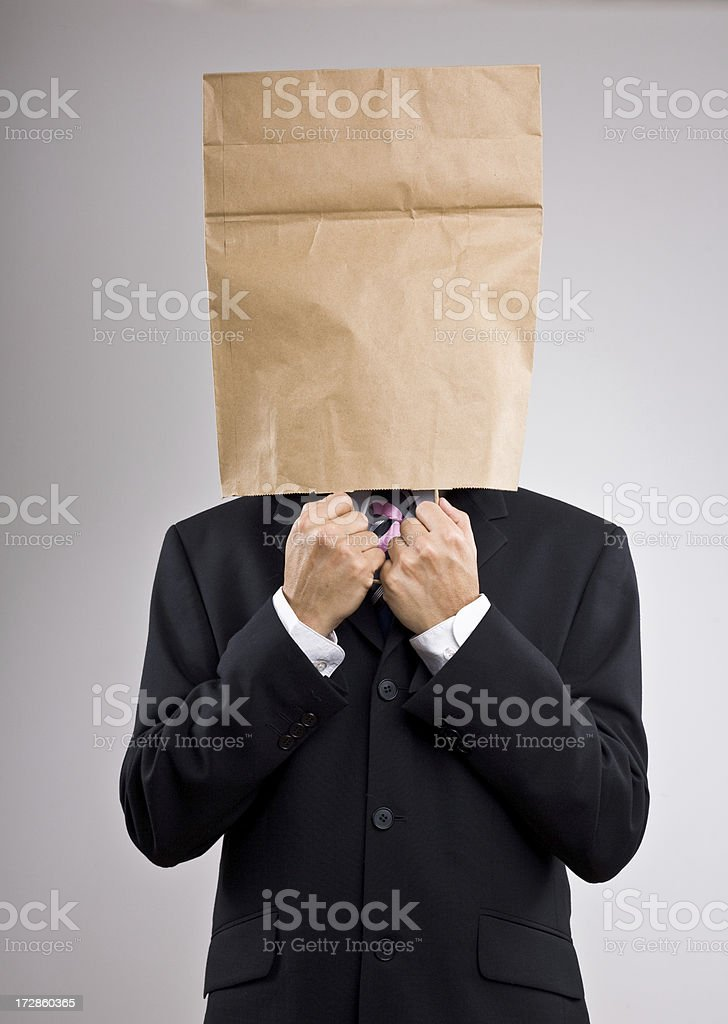 Man in a suit with paper bag on his head royalty-free stock photo