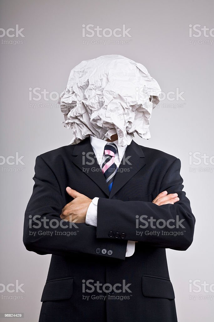 Man in a suit with paper on his head royalty-free stock photo