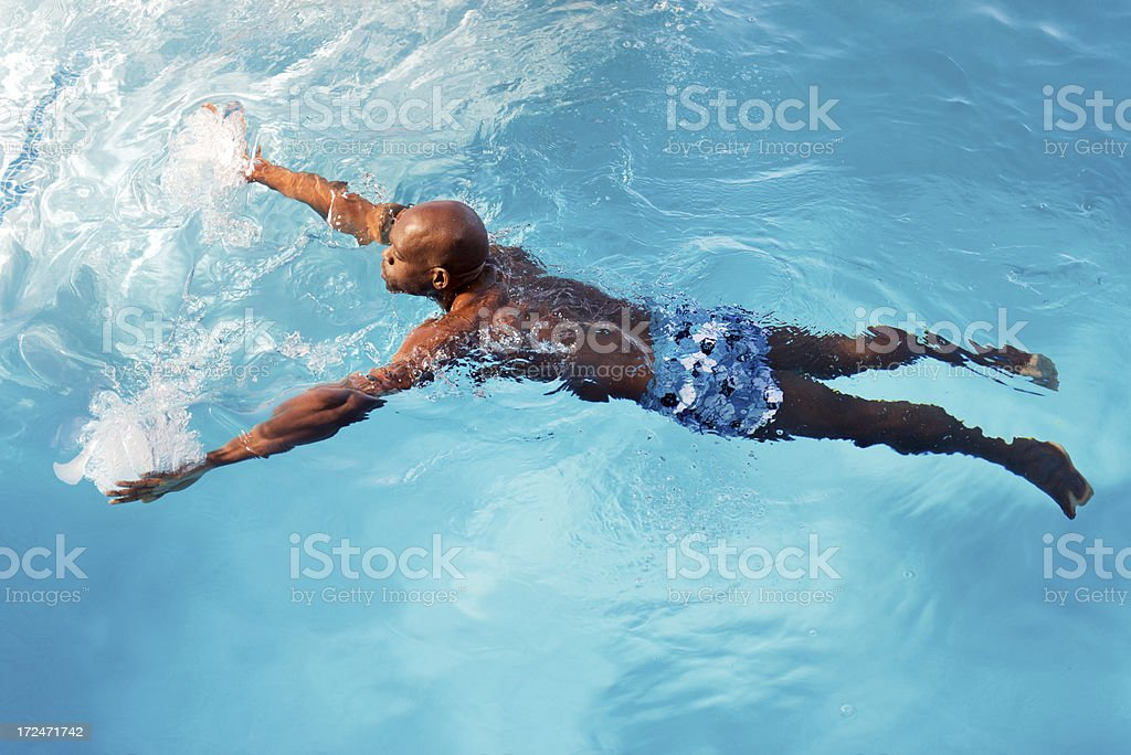 Man in a swimming pool royalty-free stock photo