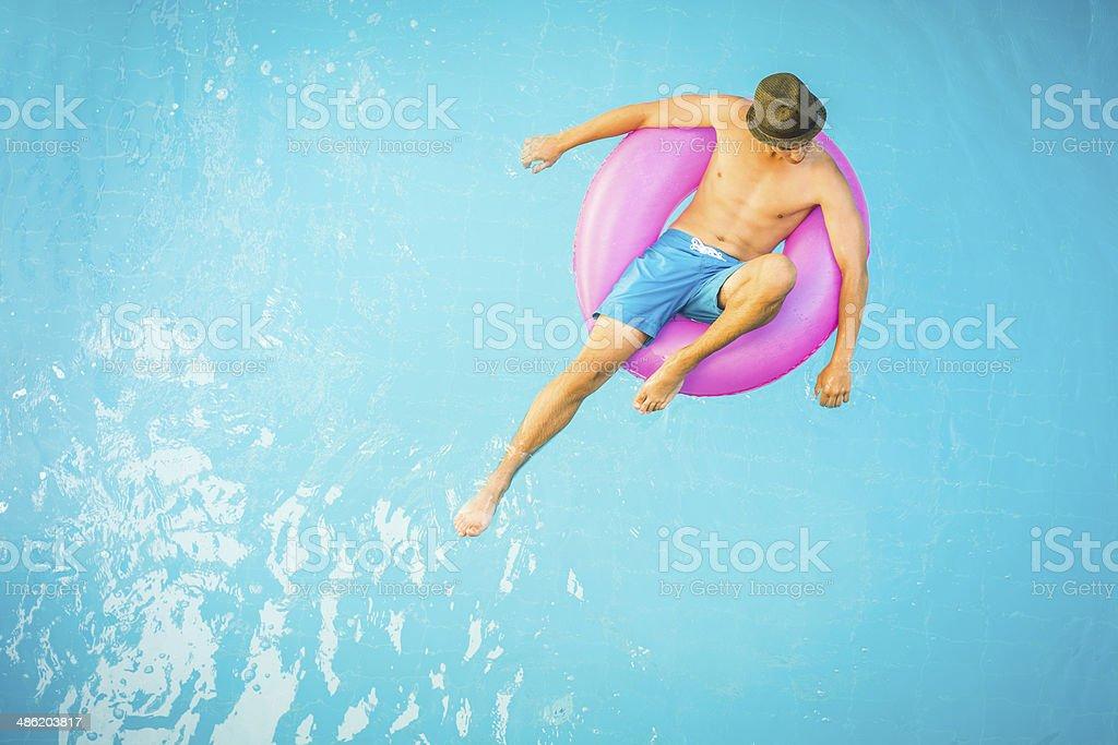 Man in a swimming pool stock photo