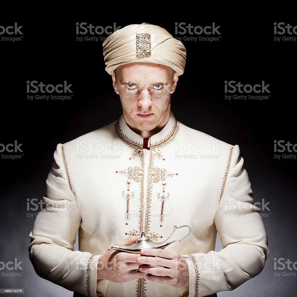 A man in a traditional Asian costume stock photo