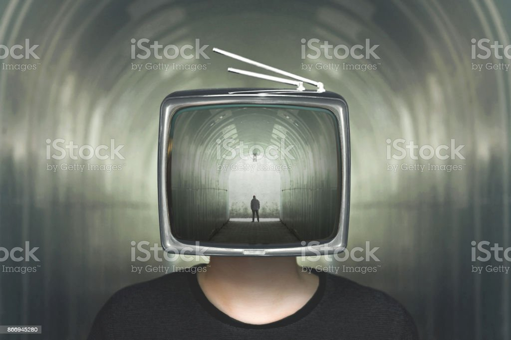man in a tunnel television control stock photo