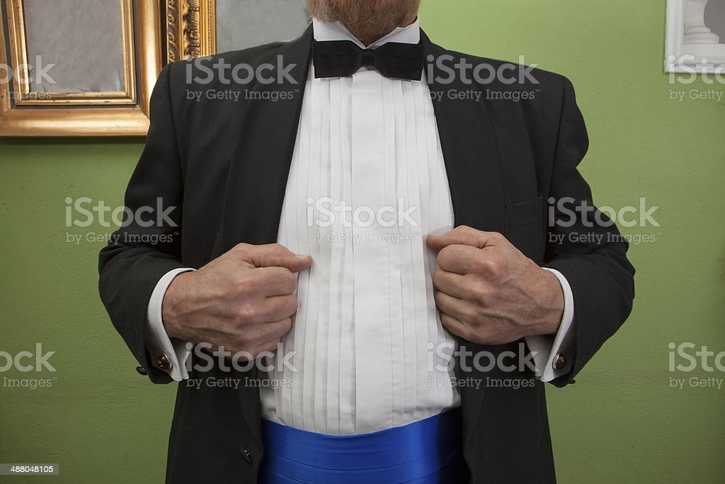 Man in a tuxedo goes to party stock photo