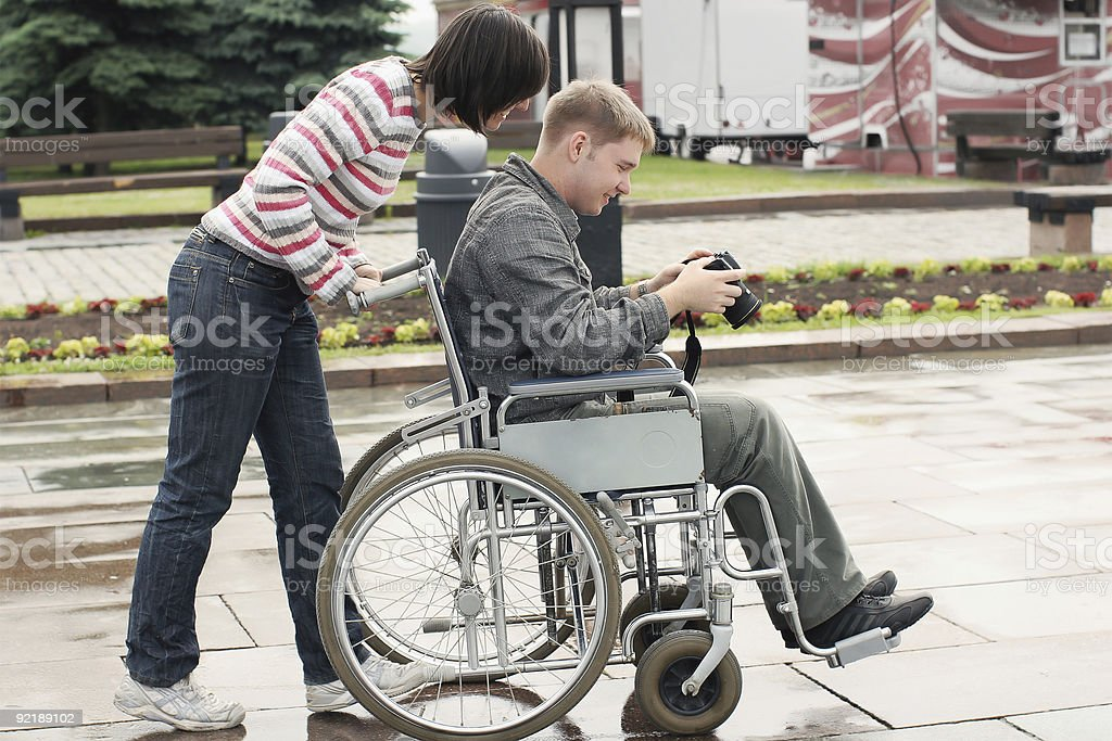 Man in a wheelchair with camera royalty-free stock photo